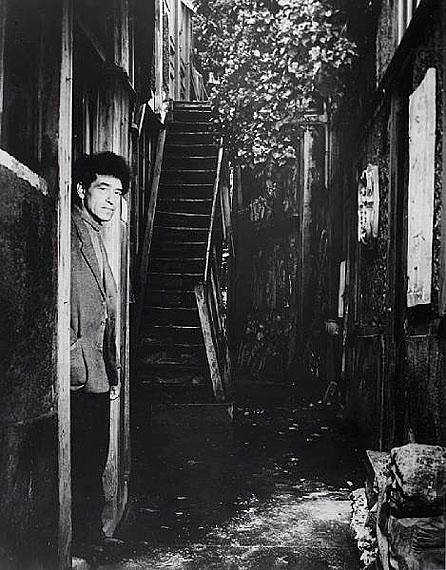 Giacometti at gate of his studio - Paris rue H. Maindrou 14 January 1948 photo by Brassaï Gyula Halász