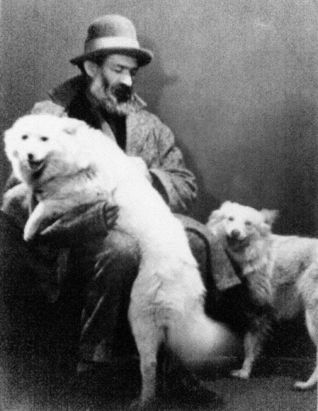 Constantin Brancusi and his dogs. Photo by Man Ray
