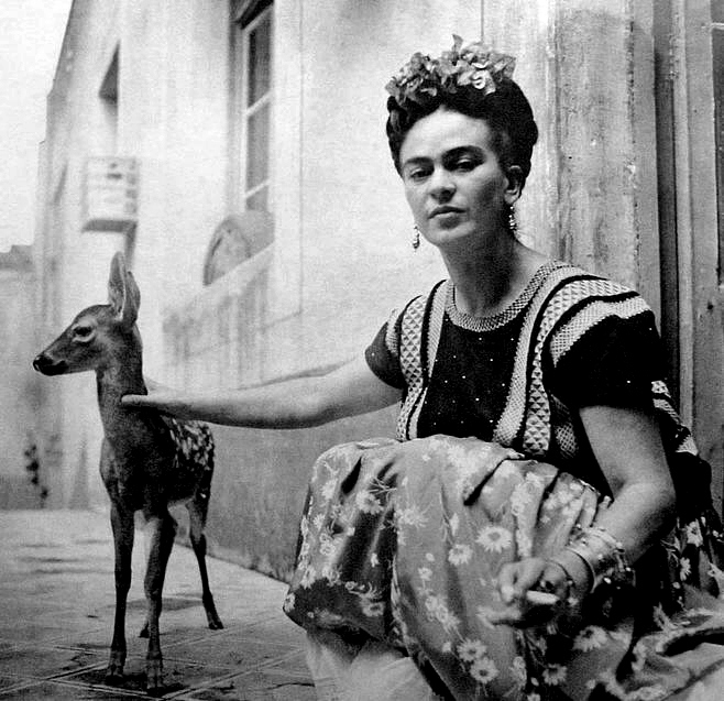 Frida Kahlo with her pet baby deer, Granizo, in 1939