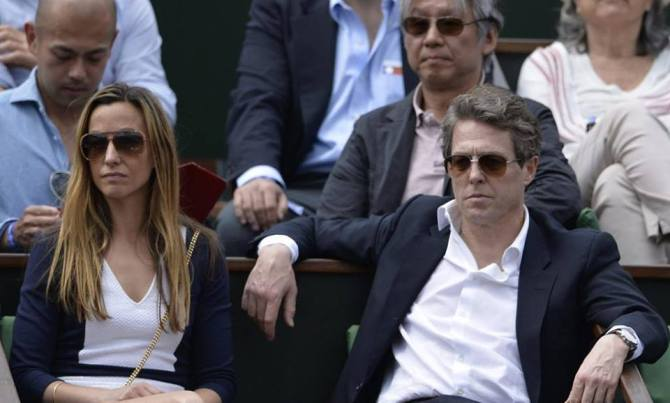 Hugh Grant watching Federer's match
