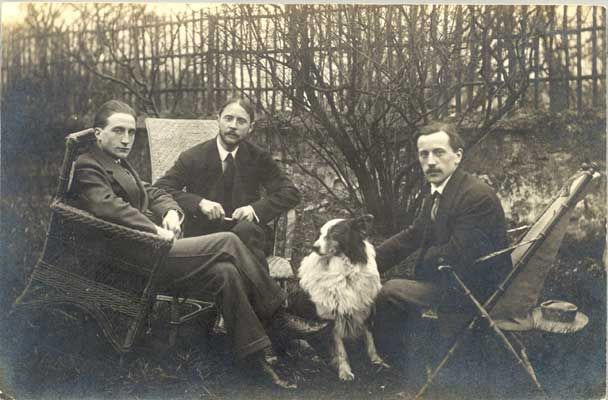 Marcel Duchamp, Jacques Villon and Raymond Duchamp-Villon. Seated in the garden of Jacques' studio in Pateaux with a collie dog 1914