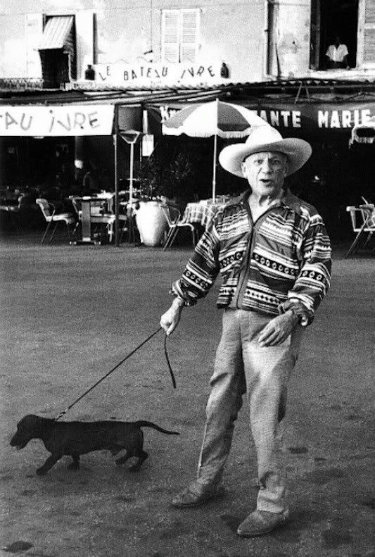 Pablo Picasso with his dog Lump