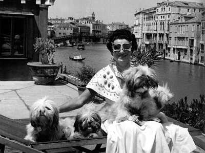 Peggy Guggenheim with her dogs on the roof of her Venetian palazzo by David Seymour, 1950