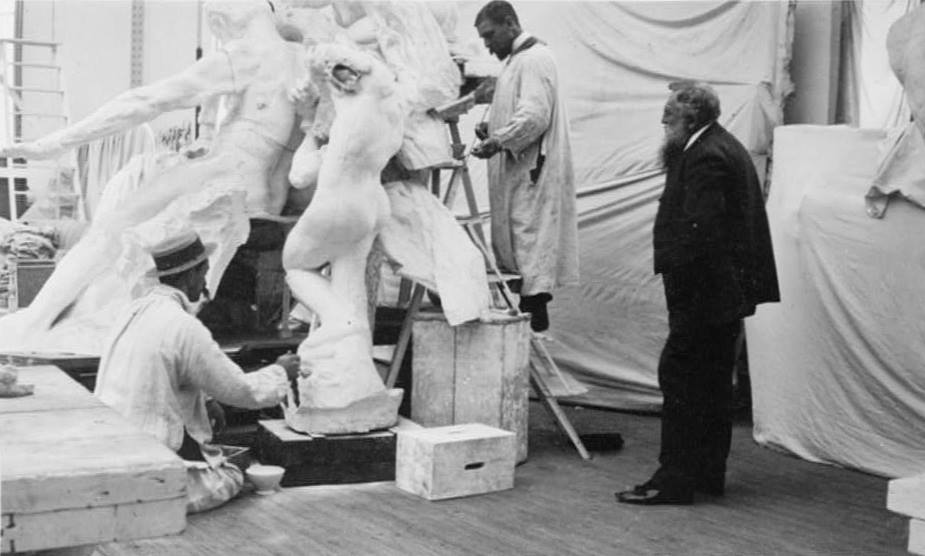 Auguste Rodin observing work on the monument to Victor Hugo at the studio of his assistant Henri Lebossé in 1896