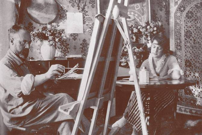 Henri Matisse with model Henriette Darricarrere - in the pose of the Liseuse au gueridon - 1921