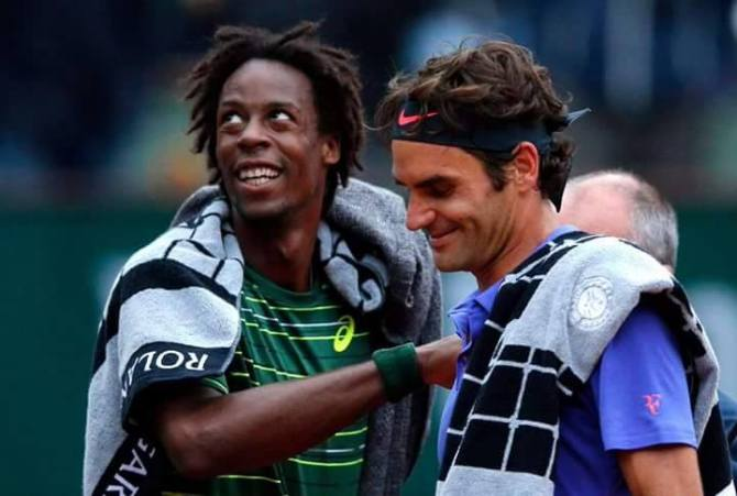 monfils and federer after first day