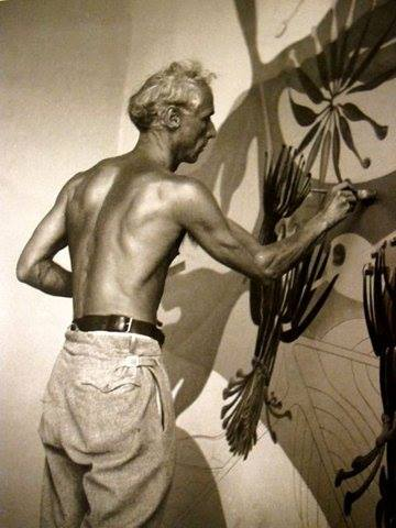 04. Max Ernst working _sans shirt_ on his murals for the Corso Bar - Zürich - 1934