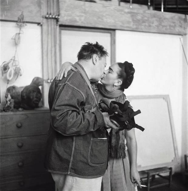 Frida Kahlo and Diego Rivera (with gas mask) kissing, Coyoácan, 1938