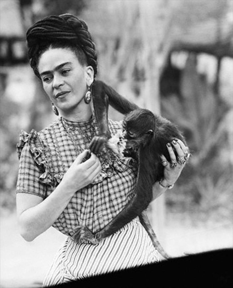 Frida Kahlo holding her pet monkey, Mexico City, 1944