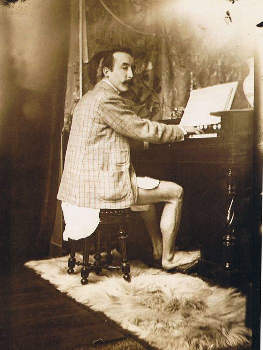 Paul Gauguin playing Mucha's harmonium in his studio - Rue de la Grande Chaumière, Paris c.1893-1994