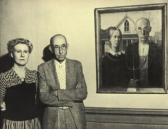 04 Nan Wood Graham and Dr. Byron McKeeby pose beside the classic painting they modeled for, Grant Wood's American Gothic