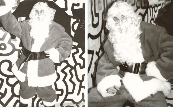 Keith Haring posing in a Santa suit