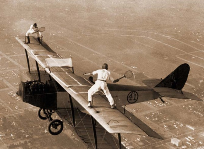 Gladys Roy and Ivan Unger play tennis on the wing of a biplane in flight, 1925. (Matt Hale Museum Syndicate)