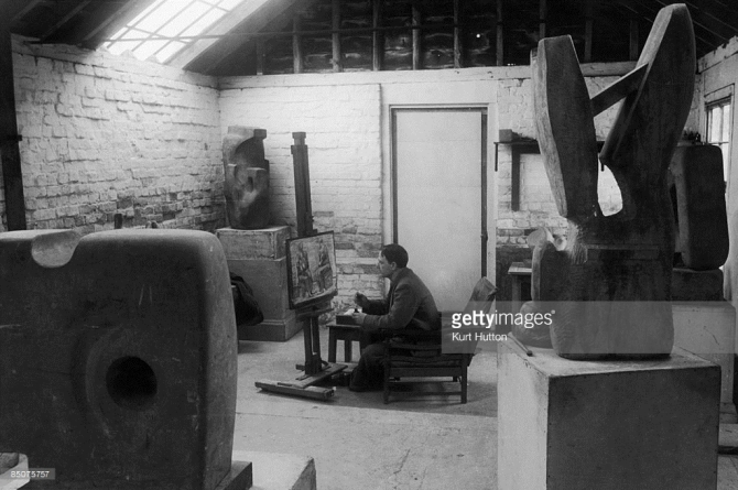 Henry Moore (1898 - 1986) at work in his studio, a converted stable in Hertfordshire, July 1945