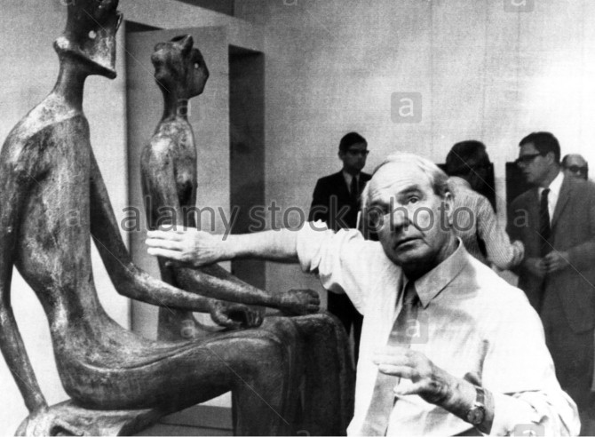Henry Moore, (1898-1986), explaining his sculpture 'King and Queen' at Dusseldorf's Art Hall, Germany, July