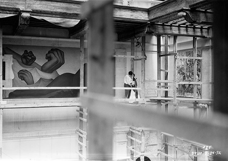 Diego Rivera and Frida Kahlo kiss on the scaffolding in Detroit