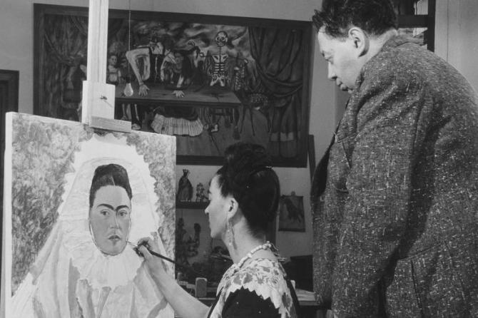 Frida Paints Self Portrait While Diego Observes, c. 1940