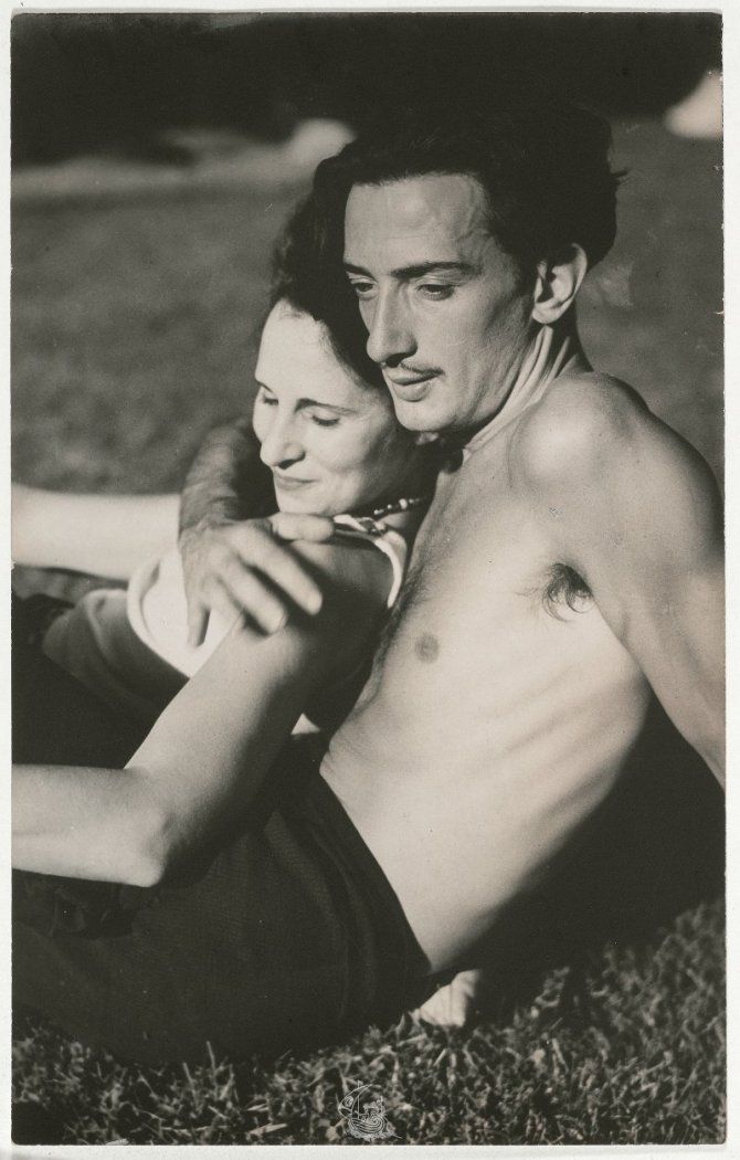 Salvador Dalí and Gala, lying on the grass in an affectionate attitude ca. 1933