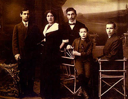 The Rothkowitz children - Albert is on the left, then Sonia, the man with mustache is unidentified, then Marcus and Morris. Probably taken before 1910