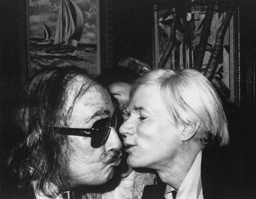 Salvador Dali wearing Christian Dior sunglasses whilst greeting Andy Warhol in Studio 54