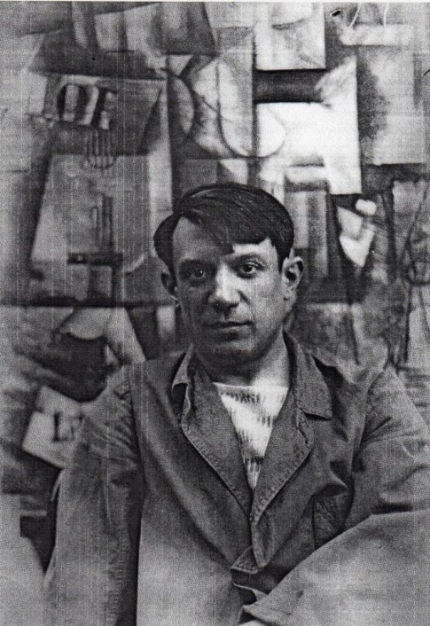 Pablo Picasso front his painting ca. 1912