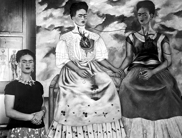 Frida Kahlo shown with her painting 'Me Twice' in 1939