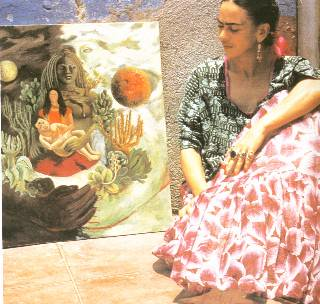 Photo of Frida Kahlo in front of her painting The Love Embrace of the Universe
