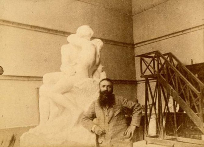 Rodin in his studio, leaning on The Kiss, circa 1888-1889