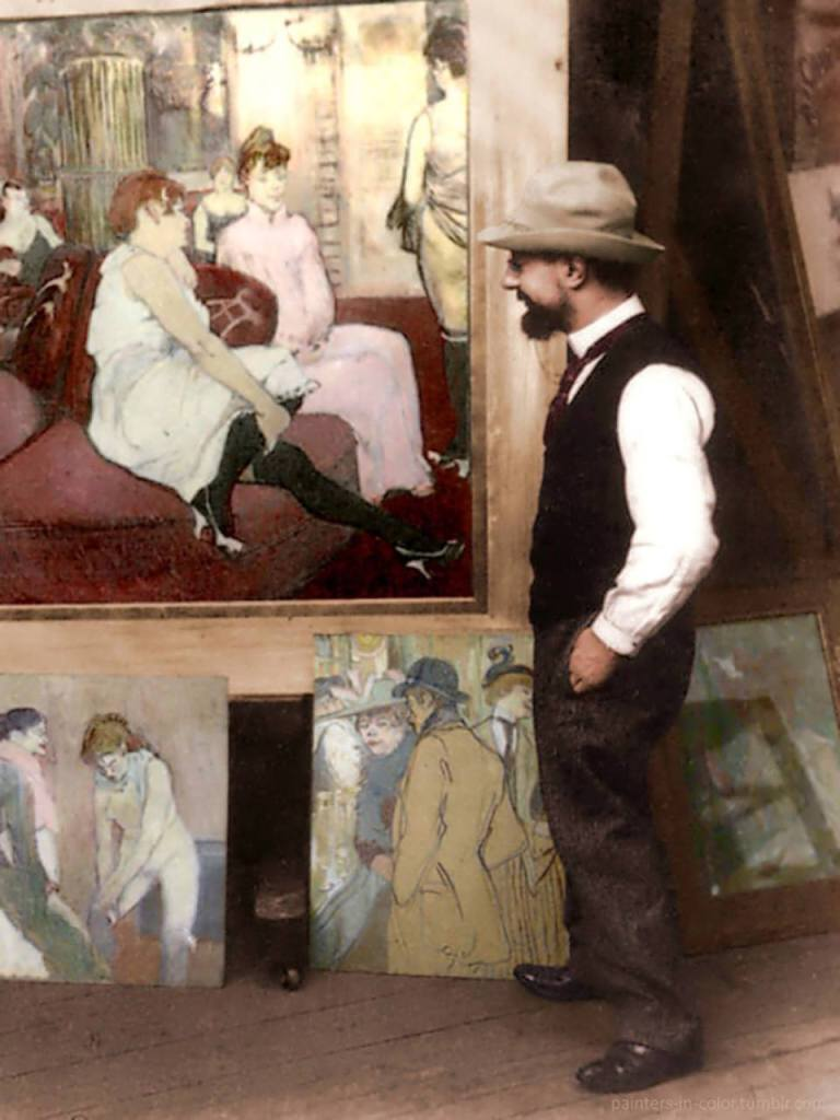 henri-toulouse-lautrec-in-his-atelier-standing-beside-his-paintings-1894