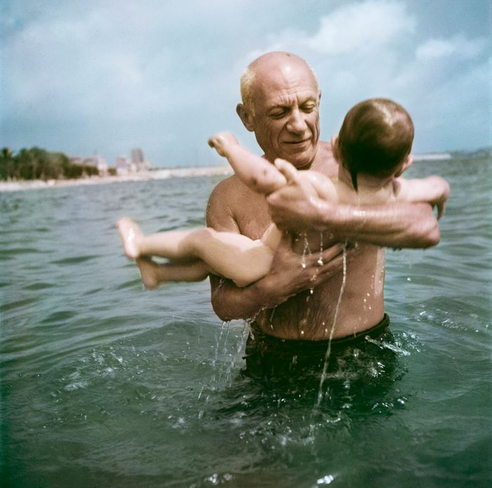 Pablo Picasso playing in the water with his son Claude, Vallauris, France