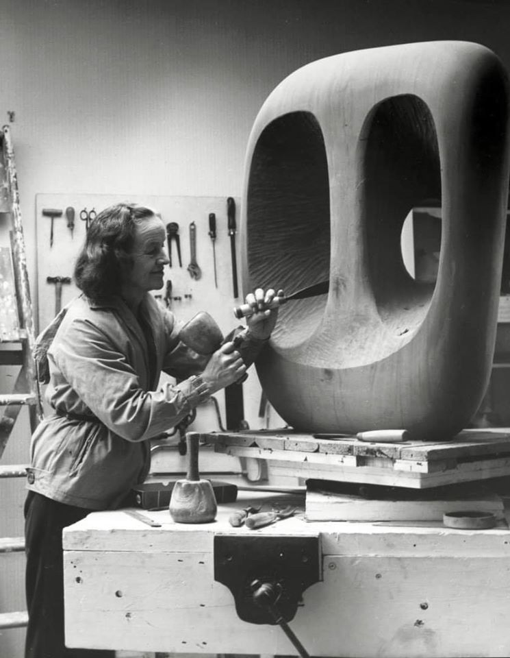Barbara Hepworth in the Palais studio in 1963 with unfinished wood carving Hollow Form with White Interior