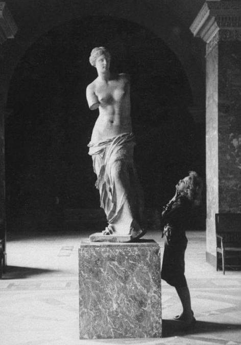 Visitor with Venus de Milo at Musée du Louvre, Paris in 1960s